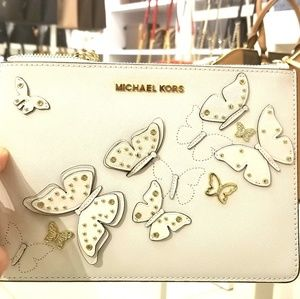MK BUTTERFLIES JST XL ZIP CLUTCH IN OPTIC WHITE